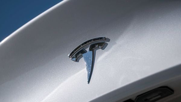 A badge is displayed on a Tesla vehicle. (File photo) (Bloomberg)