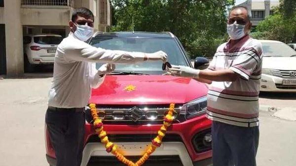 File photo of a customer receiving a new Maruti Suzuki Vitara Brezza. (Image used for representational purpose only.