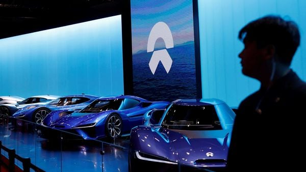File photo - A man is silhouetted in front of NIO cars at the auto show, in Shanghai. (REUTERS)