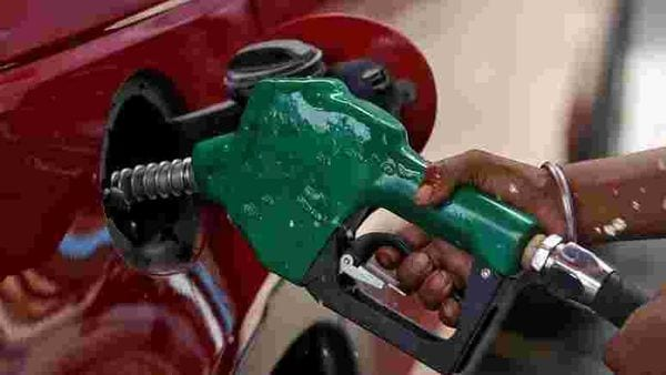 A worker holds a nozzle to pump petrol into a vehicle at a fuel station in Mumbai. (File photo) (REUTERS)
