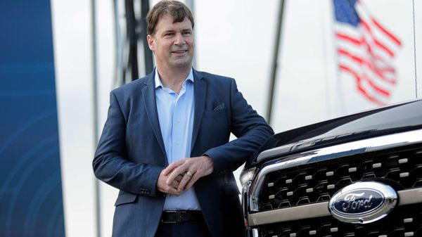 Ford Motor CEO Jim Farley poses next to a new 2021 Ford F-150 pickup truck at the Rouge Complex in Dearborn, Michigan, US (REUTERS)