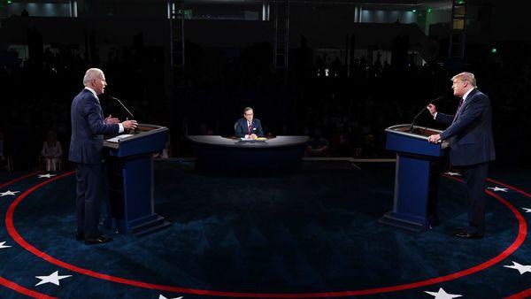US President Donald Trump, right, speaks as Joe Biden, 2020 Democratic presidential nominee, listens during the first US presidential debate. (Bloomberg)