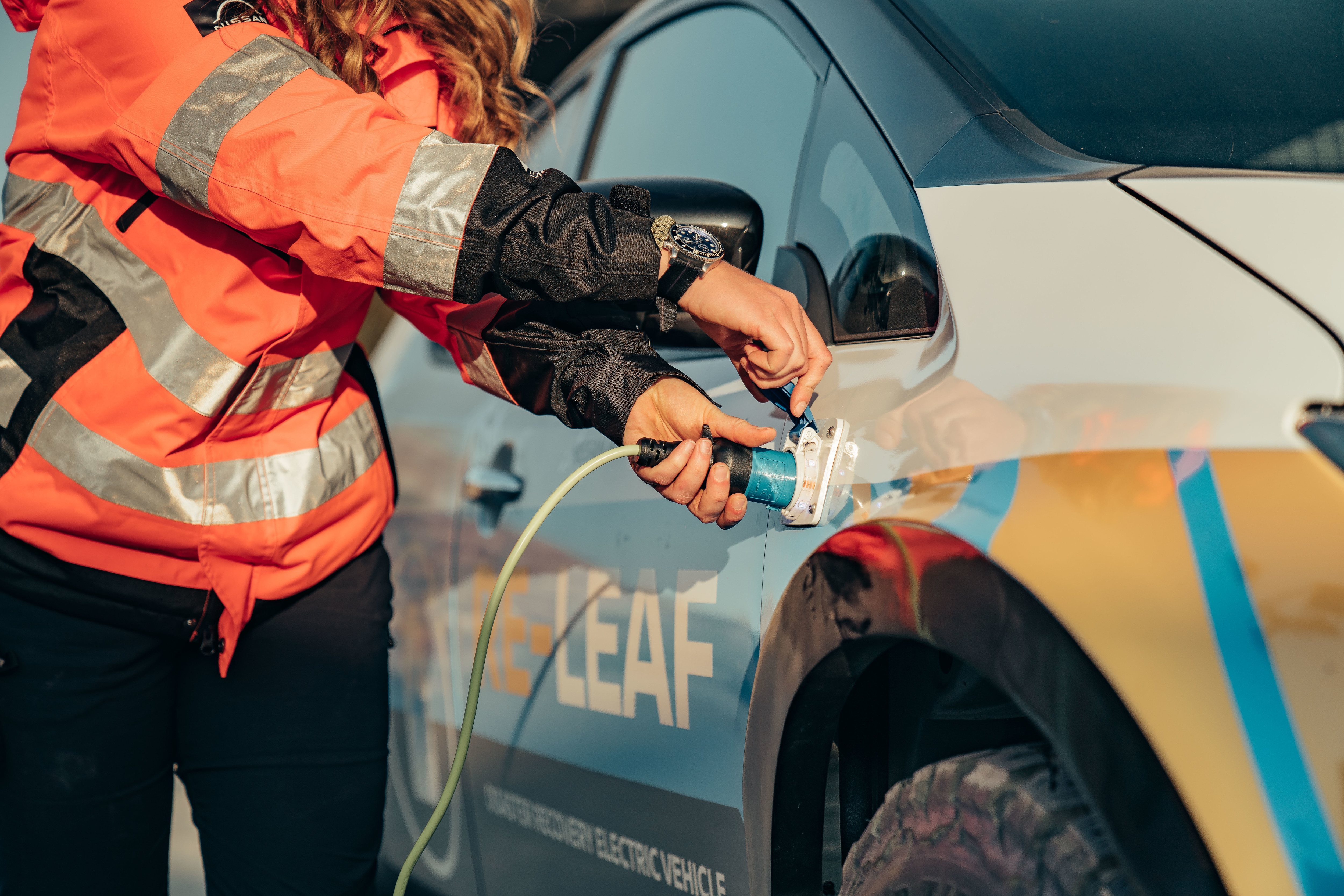 It features weatherproof plug sockets mounted on the outside of the body and this enables 110 to 230 volt devices to be powered by drawing energy from the vehicle's lithium-ion battery