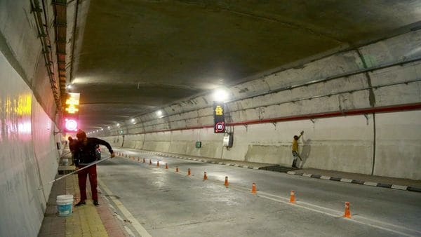 Labourers work inside the newly constructed Atal Tunnel on the Leh-Manali highway. (REUTERS)