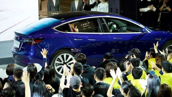 File photo - A Tesla China-made Model 3 vehicle owner sits inside a car during a delivery event at Tesla's Shanghai factory. (REUTERS)