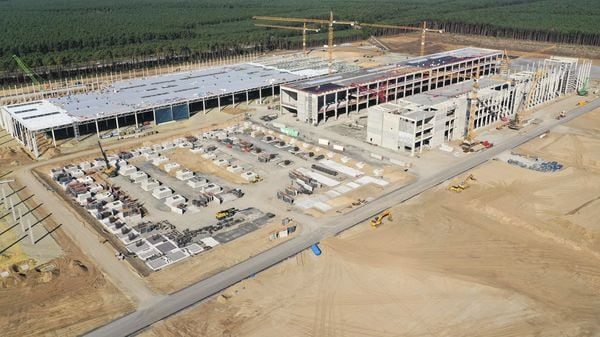 Construction cranes stand among building structures at the Tesla Inc. Gigafactory site in this aerial view in Gruenheide, Germany, on Sept. 20, 2020. (Bloomberg)