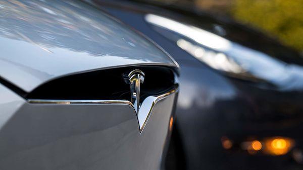 A Tesla badge is displayed on a Model X electric vehicle in San Ramon, California. (Bloomberg)