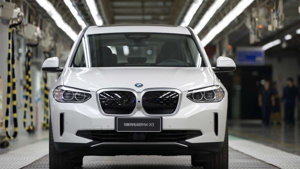 BMW's first iX3 model being rolled out of its China facility.