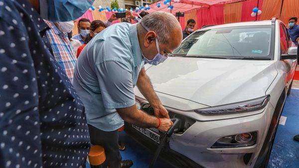 Delhi's Deputy Chief Minister Manish Sisodia during the inauguration of an electric vehicle charging station, at 11KV substation, Patparganj. (PTI)