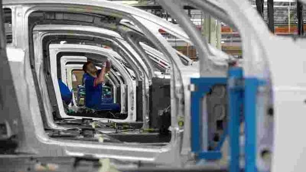 An employee works on the automobile assembly line. (Representational photo) (REUTERS)