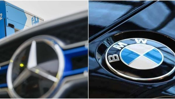 Logos of Daimler's Mercedes (L) and BMW