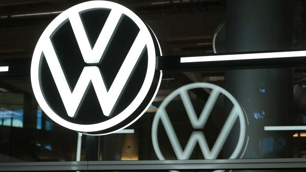 A Volkswagen (VW) logo sits on display in the visitors area of the Volkswagen AG e-Golf electric automobile factory in Dresden, Germany. (Bloomberg)