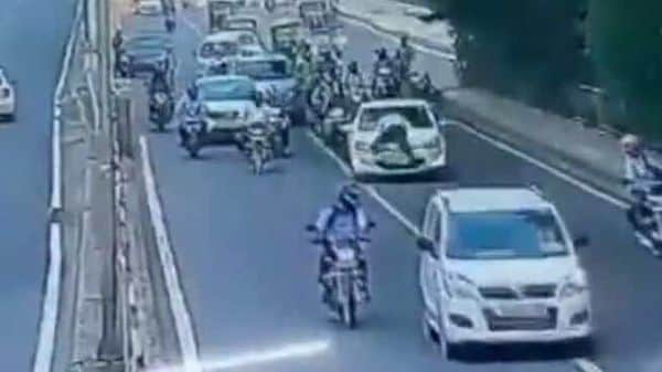 Screenshot from a CCTV footage which captured the incident of a driver continuing to drive despite a traffic official trying to make him stop.