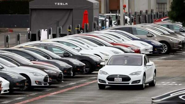 A Tesla Model S electric vehicle drives along a row of occupied superchargers at Tesla's primary vehicle factory. (File Photo) (REUTERS)