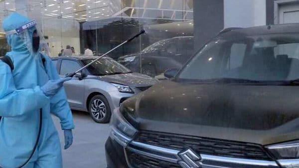 File photo - A vehicle being sanitized at a Maruti Suzuki showroom.