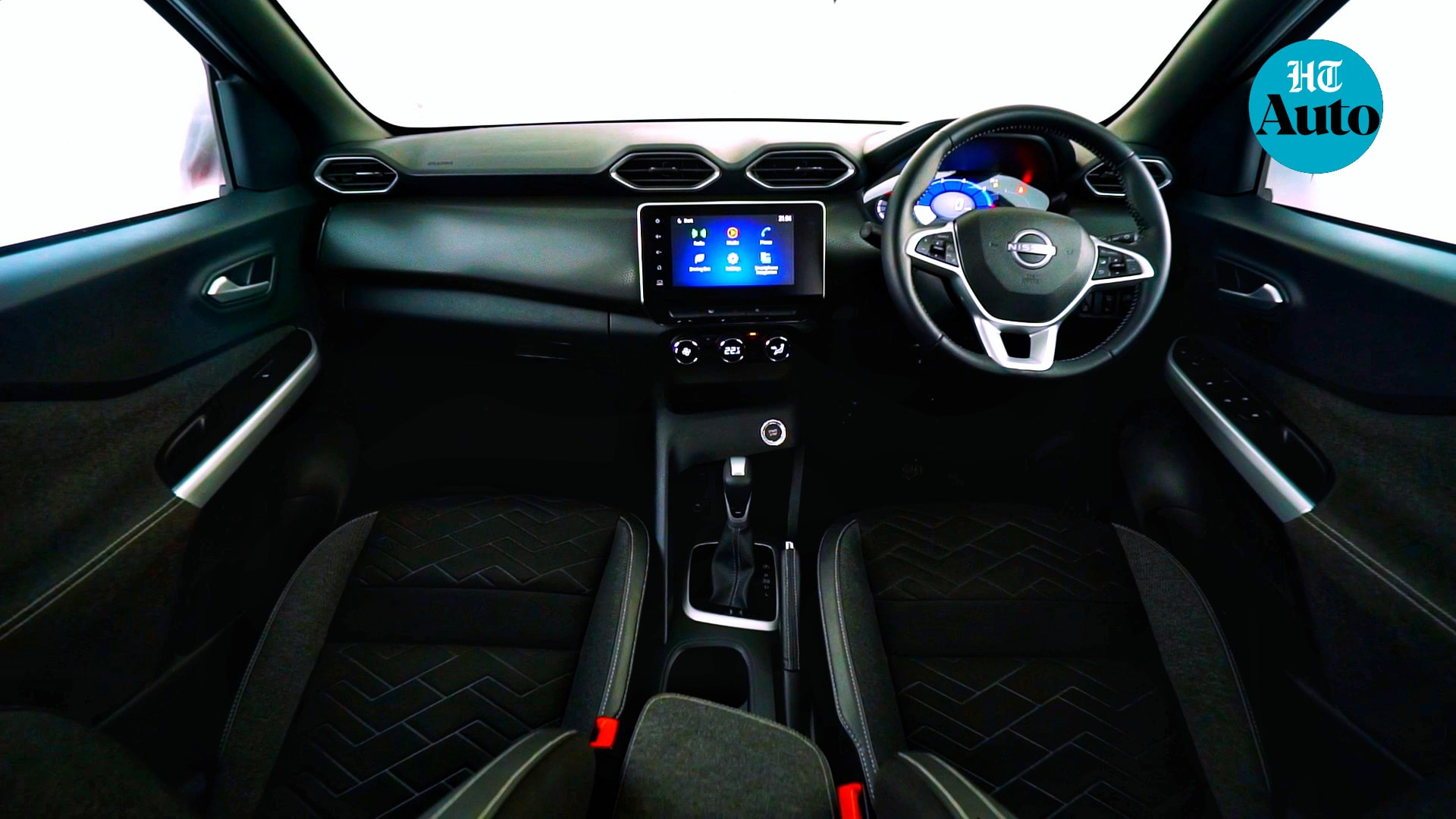 Step inside the Magnite and there's an eight-inch infotainment screen that offers wireless Android Auto and Apple CarPlay. This also puts out rear parking feed as well as a side camera feed which may be helpful during parallel parking. There are six speakers inside the car. (HT Auto/Sabyasachi Dasgupta)