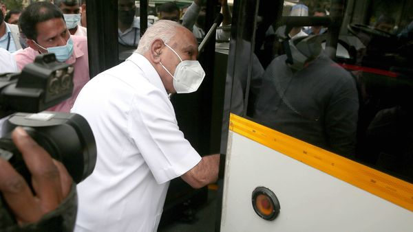 Chief Minister B S Yeddyurappa takes a look at Olectra, an electric bus launched by DCM and Transport Minister Lakshman Savadi for BMTC, in Bengaluru on Thursday.