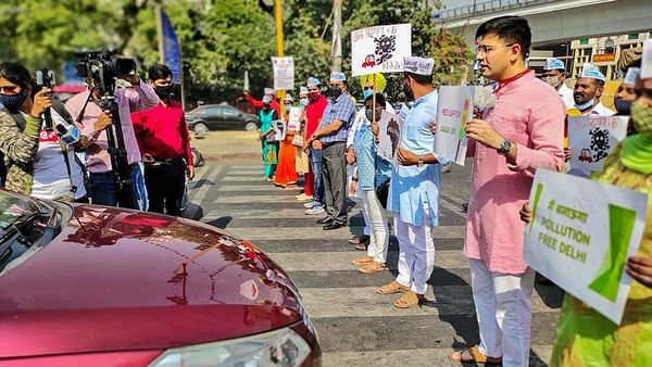 File photo: AAP MLA Raghav Chadha, along with volunteers from his constituency, urges commuters at a busy intersection to do their bit to fight air pollution as part of the Red Light On, Engine Off campaign, launched by Chief Minister Arvind Kejriwal, in New Delhi. (PTI)