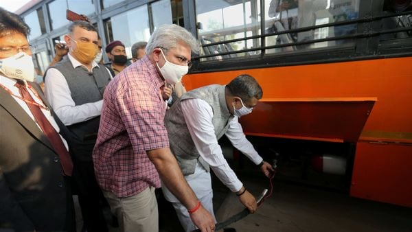 New Delhi: Union Petroleum Minister Dharmendra Pradhan and Delhi Transport Minister Kailash Gehlot after inaugurating Hydrogen-Enriched Compressed Natural Gas (HCNG) dispensing plant, at Rajghat bus depot in New Delhi, Tuesday, Oct. 20, 2020. (PTI Photo)(PTI20-10-2020_000127B) (PTI)