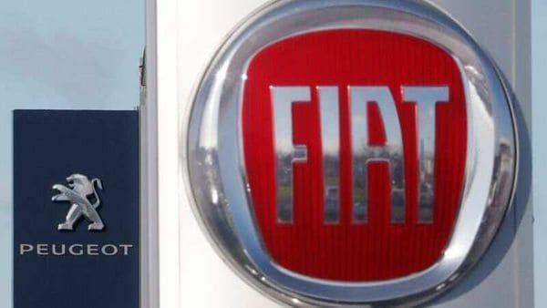 The logos of car manufacturers Fiat and Peugeot are seen in front of dealerships of the companies in France. (File photo) (REUTERS)