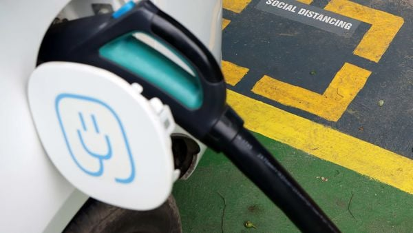 A charging plug is connected to an electric vehicle (EV) at a charging station. (Representational photo) (Bloomberg)