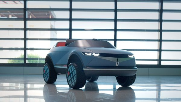 Hyundai's smallest EV gets a Performance Blue exterior color with orange accents.