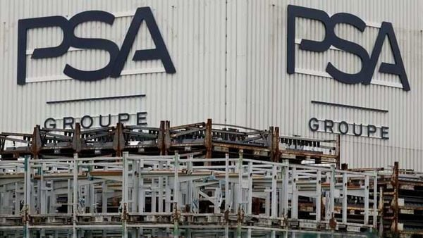 FILE PHOTO: The logo of PSA Peugeot Citroen is seen at the company's plant in Poissy, near Paris. (REUTERS)