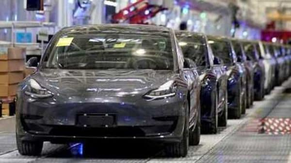 Tesla China-made Model 3 vehicles are seen during a delivery event at its factory in Shanghai. (File Photo) (REUTERS)