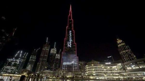 Dubai's Burj Khalifa, the world's tallest building, lit up with unique Porsche Taycan animation.