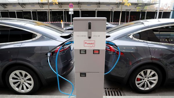 File photo: Tesla Model X electric cars recharge their batteries.