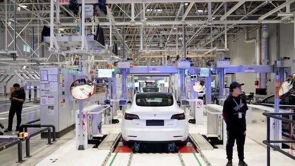 Tesla China-made Model 3 vehicles are seen during a delivery event at its factory in Shanghai, China. (REUTERS)