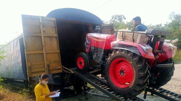 A Mahindra tractor being driven into a railway carriage. (Photo courtesy: Twitter handle of Piyush Goyal)