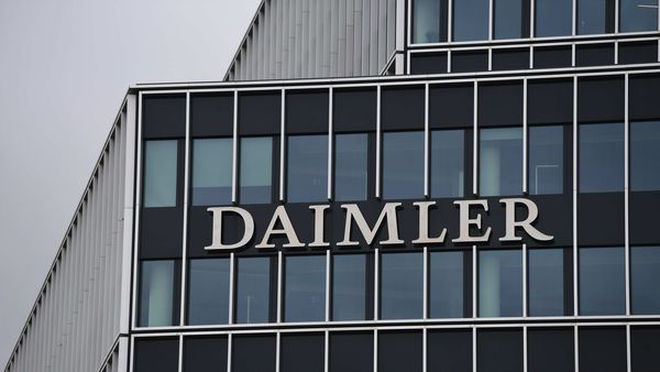 A logo sits beside office windows at the Daimler AG headquarters in Stuttgart, Germany. (File photo) (Bloomberg)