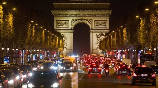 Traffic on the Champs Elysees, ahead of a national lockdown, in Paris, France. (Bloomberg)