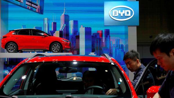 File photo: Men clean a BYD electric vehicle (EV) e2 (REUTERS)