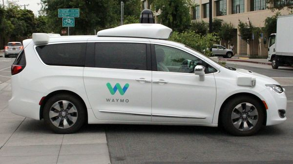 File photo: A Waymo self-driving car pulls into a parking lot at the Google-owned company's headquarters in Mountain View, California. (AFP)