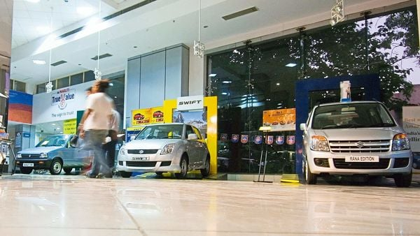 File photo: Maruti Suzuki has a dealer network of over 3,086 showrooms across the country. (MINT_PRINT)