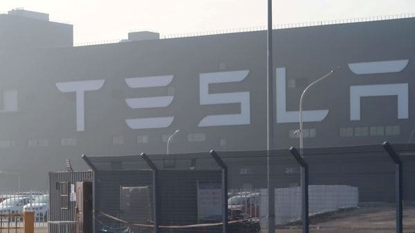 FILE PHOTO: A Tesla sign is seen on the Shanghai Gigafactory of the US electric car maker before a delivery ceremony in Shanghai, China (REUTERS)