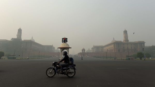 New Delhi: A man rides a motorcyle amid low visibility due to smog, in New Delhi, Monday, Nov. 9, 2020. The national capital's air quality remained �severe� for the fifth consecutive day on Monday, with calm wind speed exacerbating the effect of stubble burning. (PTI Photo/Atul Yadav)(PTI09-11-2020_000060A) (PTI)