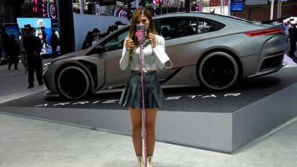 File photo of a blogger as she prepares to record herself during the Beijing Auto Show. (AP)
