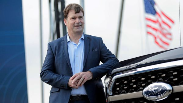 File photo - Ford Motor Co. CEO Jim Farley poses next to a new 2021 Ford F-150 pickup truck at the Rouge Complex in Dearborn, Michigan. (REUTERS)