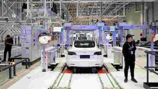 File photo - Tesla China-made Model 3 vehicles are seen during a delivery event at its factory in Shanghai, China. (REUTERS)