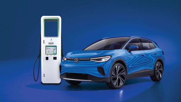 All-new 2021 ID.4 electric SUV plugged to a charging stand.