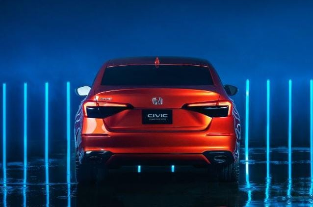 The rear profile of the prototype features larger pair of LED tail lights, new spoiler and updated dual exhaust tip and the sedan appears to stand wider than before.