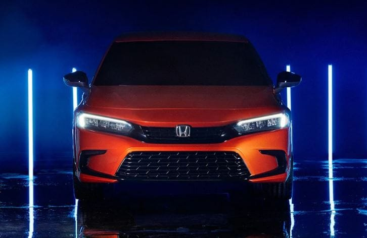 A more pronounced grille with sleeker head light units highlight the face of Honda Civic 2022 prototype.
