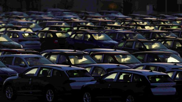 Cars are parked in the courtyard of Skoda Auto's factory as the company restarts production after shutting down in March due to the coronavirus pandemic in Mlada Boleslav, Czech Republic. (REUTERS)