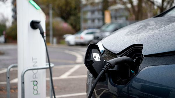 File photo of an electric vehicle charging at a charging station. (AFP)