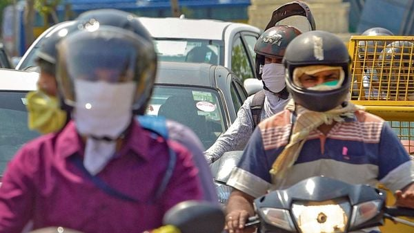 In an effort to make helmets mandatory for two-wheelers, Odisha plans stricter punishment for those riding without it. (File photo) (MINT_PRINT)