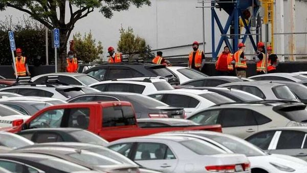 Workers in orange vests are seen outside Tesla's primary vehicle factory in Fremont, California. (File photo) (REUTERS)
