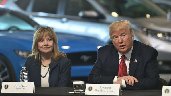 Outgoing US President Donald Trump is seen with General Motors CEO Mary Barra. (File Photo) (AFP)